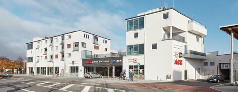 Moderne Mischimmobilie wertet Einkaufszentrum auf