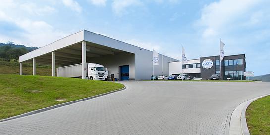 AQS Logistic Systems GmbH, Neunkirchen (Westerwald): Schlüsselfertiger Neubau einer Produktionshalle mit Bürogebäude.