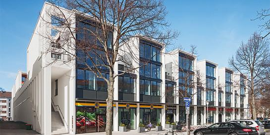 Wohn- und Geschäftshaus Forum Herrenhäuser Markt, Hannover: Schlüsselfertiger Neubau mit parkähnlichen Arkadenhöfen